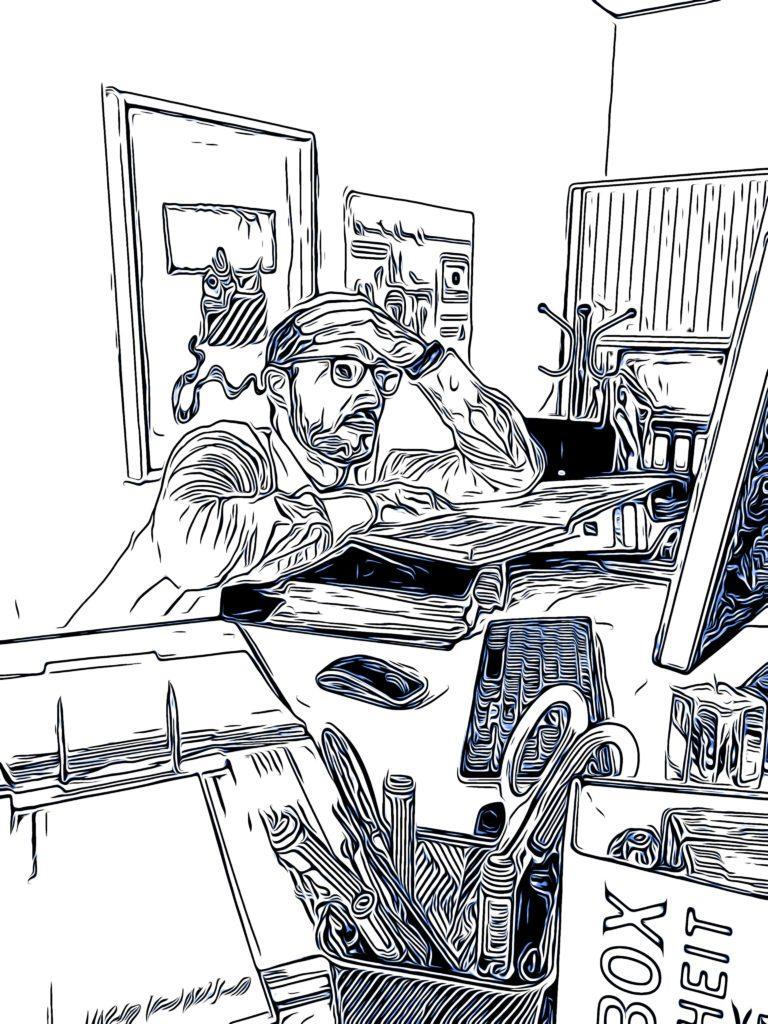 überfordert am Schreibtisch
